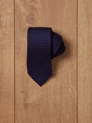 Corbata azul oscuro topos rojos y azules