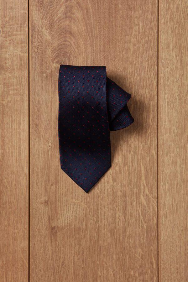 Corbata azul oscuro punto rojo