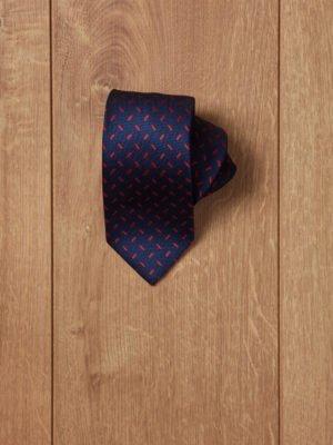 Corbata azul motivos rojos