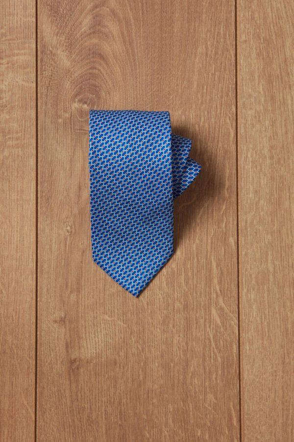 Corbata azul motivo rojo y azul