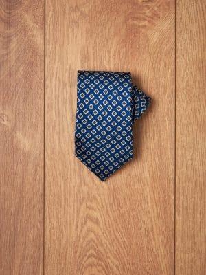 Corbata azul flores geometricas