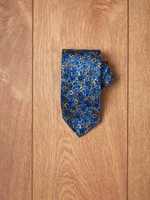 Corbata azul flores tonos amarillos