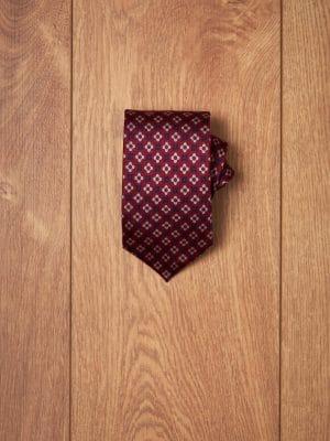 Corbata burdeos dibujos geometricos azules