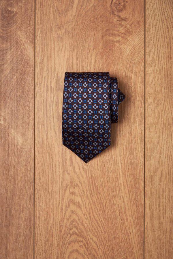 Corbata marron dibujo geometricos azules