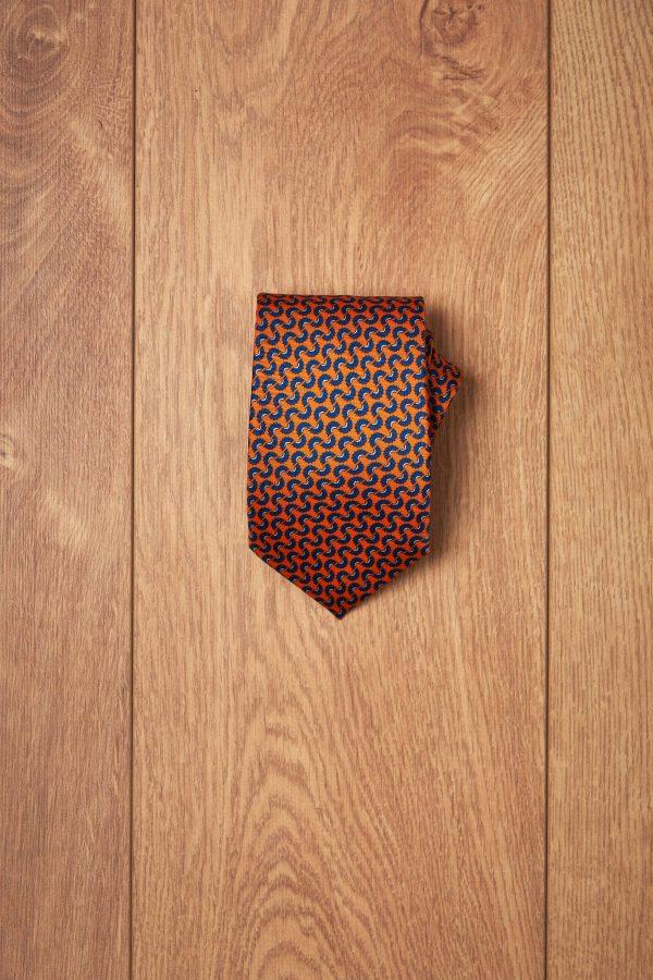 Corbata naranja estampado floral azul